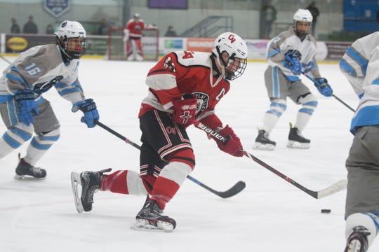 CVU's Charlie Averill (22) skates with the puck during the boys hockey game between the South Burlington Wolves and the Champlain Valley Union Redhawks at Cairns Arena on Wednesday night February 27, 2019 in South Burlington, Vermont.
