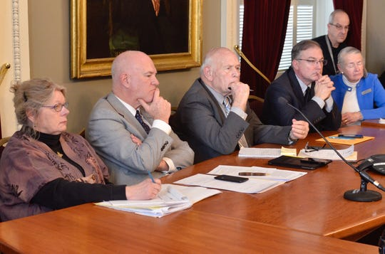 Members of the Vermont Senate Judiciary Committee listen to testimony from Alyssa and Rob Black of Essex about the death of their son, Andrew Black, at the Statehouse in Montpelier on Feb. 28, 2019.