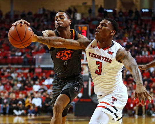 Oklahoma State's Curtis Jones (1) knocks the ball away from Texas Tech's Deshawn Corprew (3) during the first half of an NCAA college basketball game Wednesday, Feb. 27, 2019, in Lubbock, Texas. (AP Photo/Brad Tollefson)