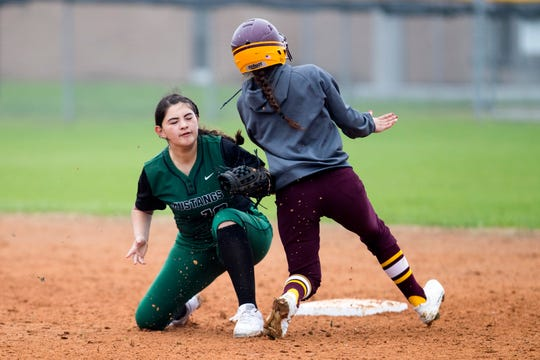 Tuloso-Midway's Jalyn Salazar is out as she tries to steal and gets tagged by King's Kaitlyn Kryssow in the game against King in the Miras' Bayfront Bash softball tournament at King High School on Thursday, February 28, 2019. King won the game 4-1.
