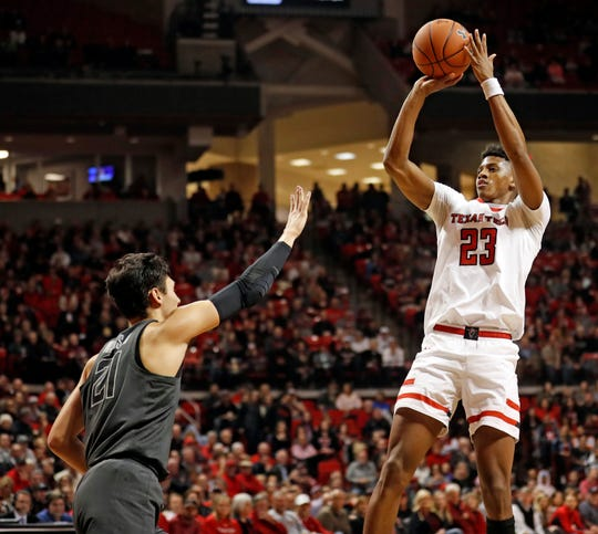 Texas Tech's Jarrett Culver (23) shoots over Oklahoma State's Lindy Water III (21) during the first half of an NCAA college basketball game Wednesday, Feb. 27, 2019, in Lubbock, Texas. (AP Photo/Brad Tollefson)