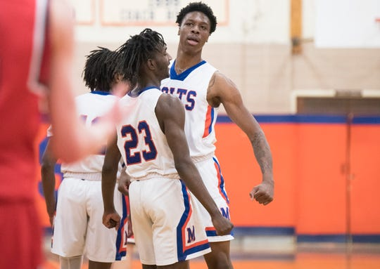 Millville's John Green, right, celebrates with Millville's Rynell Lawrence after Green dunked the ball during the 3rd quarter of the South Jersey Group 4 quarterfinal boys basketball playoff game between Millville and Lenape, played at Millville High School on Wednesday, February 27, 2018.  Millville defeated Lenape,  46-35.