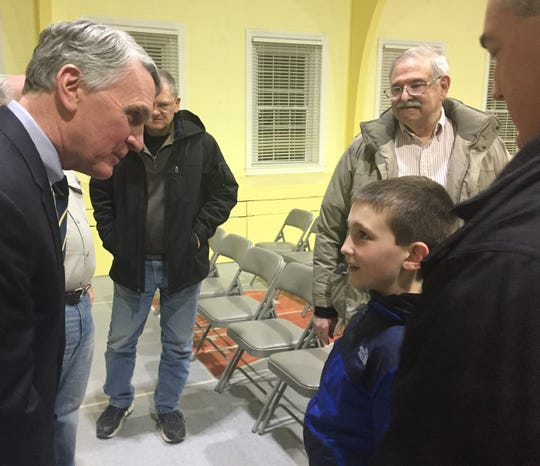Kevin Corbett, NJ Transit's executive director, speaks with Jimmy Ulrich, a Mount Laurel 9-year-old who hopes to become a locomotive engineer. The two met at a forum in Cherry Hill Wednesday.