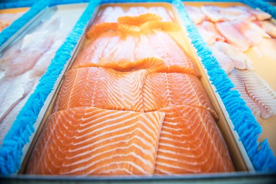 Fresh salmon fillets are displayed at Fisher's Seafoodin Willingboro on Thursday, February 21, 2019.