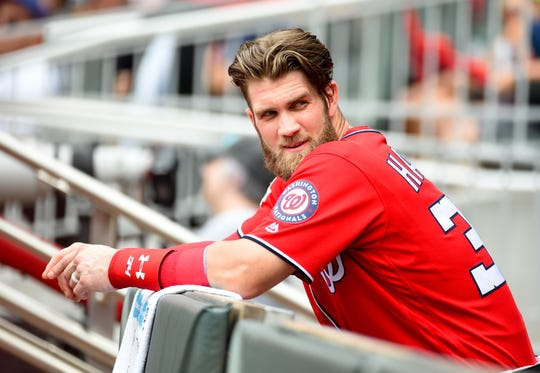 Bryce Harper (34) signed one of the biggest contracts in the history of sports on Friday, agreeing to a 13-year, $330-million deal with the Philadelphia Phillies.