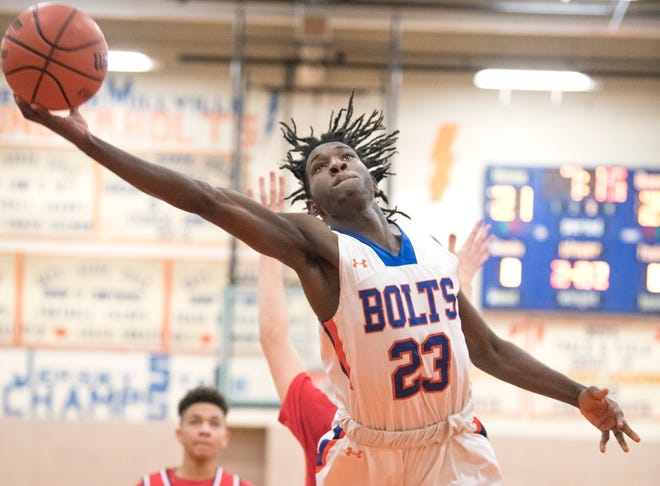 Millville's Rynell Lawrence puts up a shot during the 3rd quarter of the South Jersey Group 4 quarterfinal boys basketball playoff game between Millville and Lenape, played at Millville High School on Wednesday, February 27, 2018.  Millville defeated Lenape,  46-35.