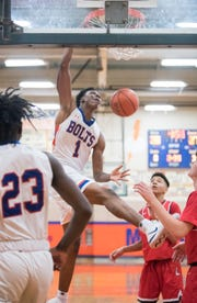 Millville's John Green dunks the ball during the 3rd quarter of the South Jersey Group 4 quarterfinal boys basketball playoff game between Millville and Lenape, played at Millville High School on Wednesday, February 27, 2018.  Millville defeated Lenape,  46-35.