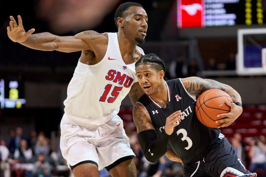 Cincinnati guard Justin Jenifer (3) drives to the basket against SMU's Isiaha Mike (15) during the first half of an NCAA college basketball game at Moody Coliseum, Wednesday, Feb. 27, 2019, in Dallas.