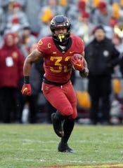 Iowa State Cyclones running back David Montgomery (32) runs the football against the Baylor Bears at Jack Trice Stadium.