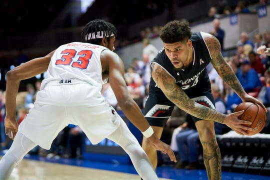 Cincinnati guard Jarron Cumberland (34) brings the ball up court against SMU's Jimmy Whitt Jr. (33) during the first half of an NCAA college basketball game at Moody Coliseum, Wednesday, Feb. 27, 2019, in Dallas.