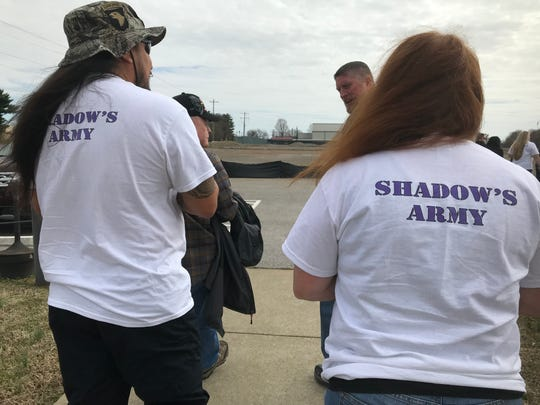 Supporters of Shadow McClaine, whose body was found in 2017, gather outside the courtroom at Fort Campbell on Wednesday.