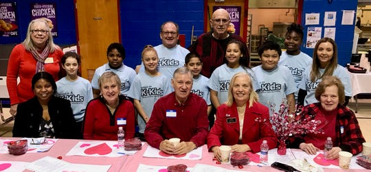 Members of School No. 4's K-Kids, along with Principal Anthony Cataline and adviser Danielle Piscino, posing with members of the Linden Kiwanis Club, which sponsors the K-Kids.
