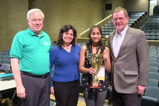 SCLSNJ County Library Administrator Brian K. Auger, SCLSNJ library commissioner and judge Corinne Fender, 2018 Spelling Bee Champion Aashi Mishra of Valley View School in Watchung and Somerset County Business Partnership President and CEO Mike Kerwin celebrate Aashi's win in 2018.