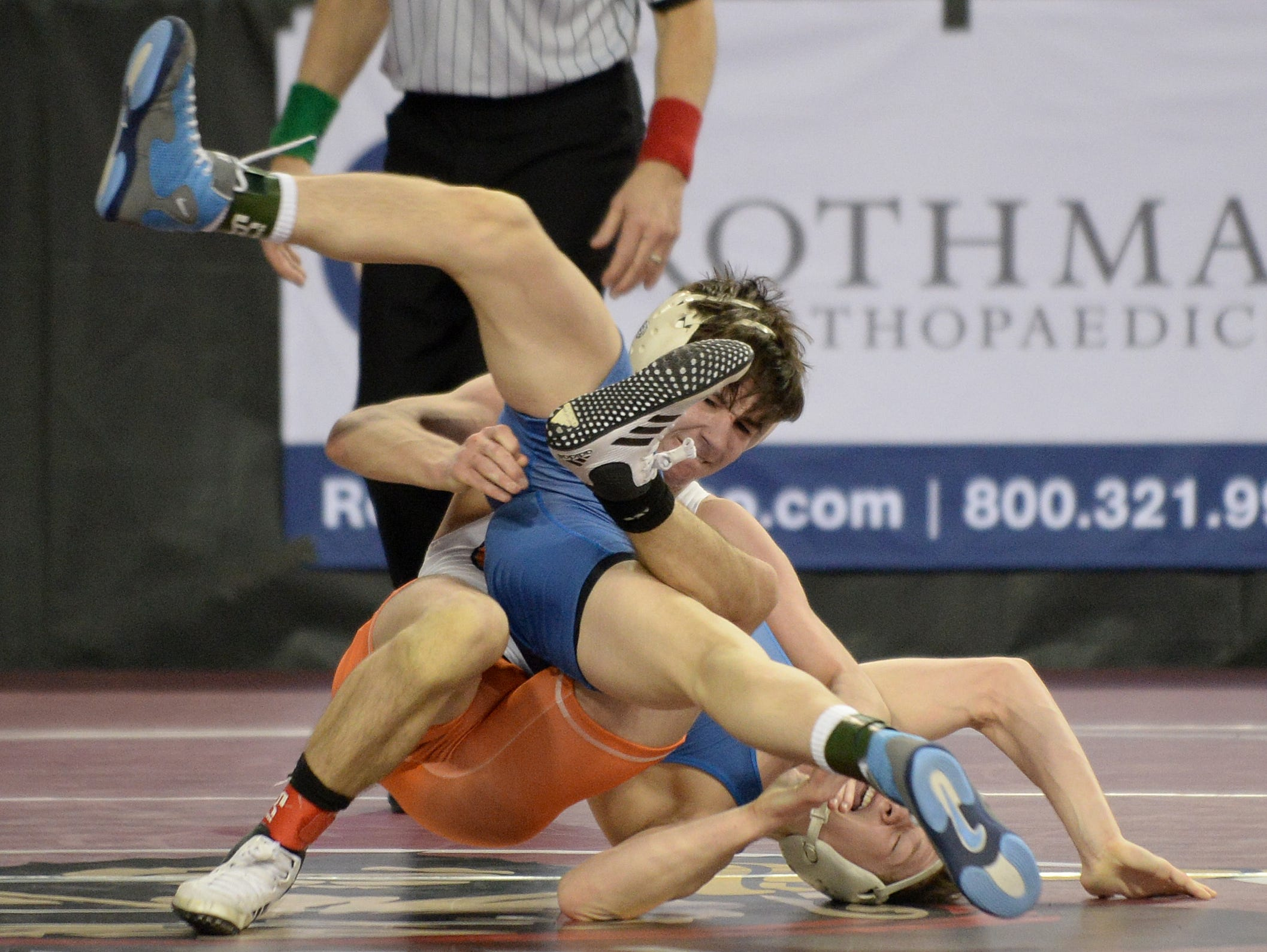 Westfield's Luke Hoerle wrestles Cherokee's Andrew Aromando in a 120-pound first round bout during the NJSIAA Individual Wrestling Championships at Boardwalk Hall in Atlantic City, Thursday, Feb. 28, 2019.