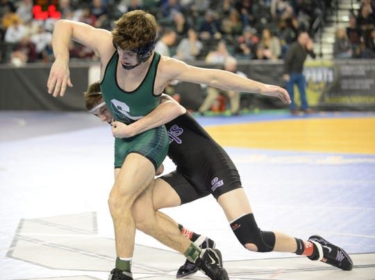 South Plainfield's Joe Sacco wrestles Old Bridge's Alec Meyers in a 145-pound first round bout during the NJSIAA Individual Wrestling Championships at Boardwalk Hall in Atlantic City, Thursday, Feb. 28, 2019.