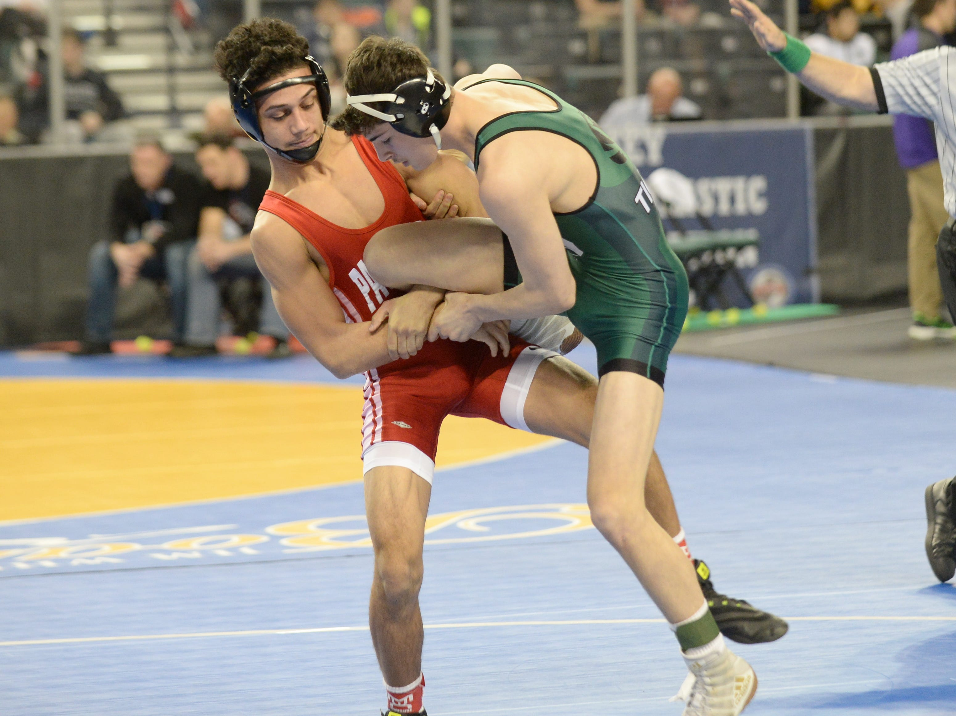 South Plainfield's Alex Amato wrestles Paulsboro's Jacob Perez-Eli in a 138-pound first round bout during the NJSIAA Individual Wrestling Championships at Boardwalk Hall in Atlantic City, Thursday, Feb. 28, 2019.