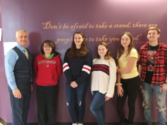 Students of the Month for February: Throughout the school year, the Middle/High School teaching staff nominates students. The nominations are based on character, school spirit, and academic integrity. For February, we are happy to announce our winners. Pictured from left to right: Principal - Dr. P. McCabe, and Middle School students: Grade 6 - T. Cannon, Grade 7- O. Gulick , Grade 8 - L. Mullen,  and High School students:  A. Zaretsky, and Z. Honimar.