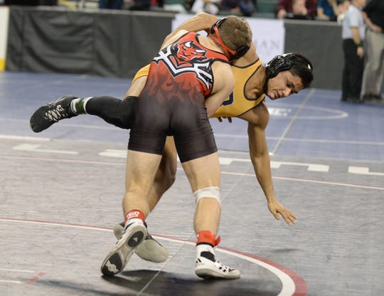 Hunterdon Central's Pasquale Vizzoni takes down Belleville's David Guerra in a 145-pound first round bout during the NJSIAA Individual Wrestling Championships at Boardwalk Hall in Atlantic City, Thursday, Feb. 28, 2019.