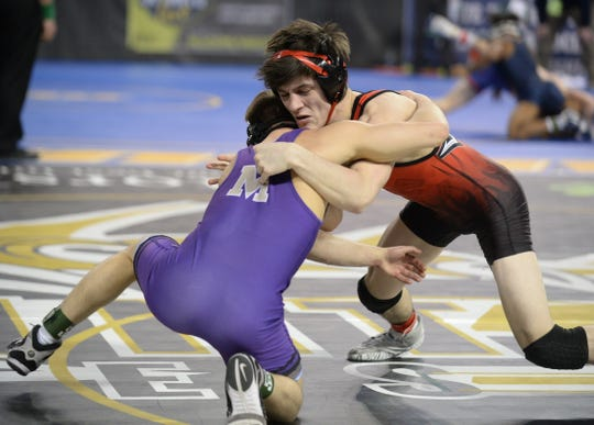 Hunterdon Central's Jack Bauer wrestles Monroe's Micheal Bilardo in a 126-pound first round bout during the NJSIAA Individual Wrestling Championships at Boardwalk Hall in Atlantic City, Thursday, Feb. 28, 2019.