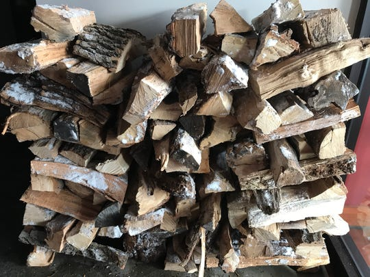Wood for the chargrill is stacked in various locations throughout Al Punto's dining room.