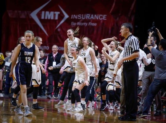 Members of the Center Point-Urbana girls basketball team react after beating Des Moines Christian during their Class 3A state semifinal game on Thursday, Feb. 28, 2019, at Wells Fargo Arena in Des Moines.