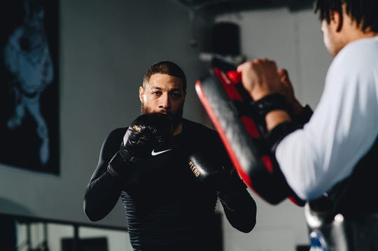 Royce White spars while training for the MMA