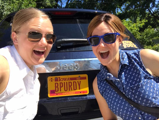 Beth Honnold, left, poses with friend friend Alana Olson by Honnold's Jeep, which has a license plate that makes some wonder if she's connected to star Cyclones quarterback Brock Purdy.