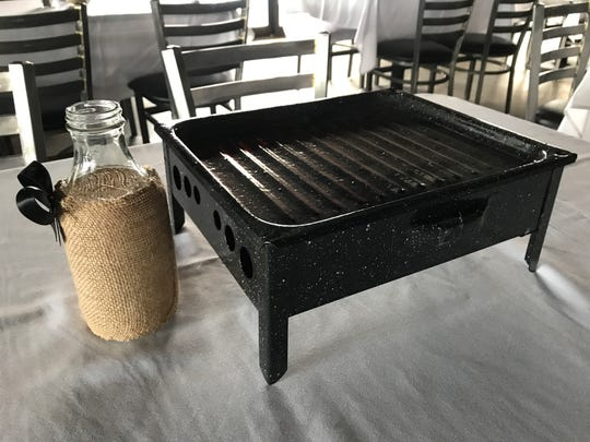 The tabletop grill at Al Punto, called a brasero or parrillada, on which chargrilled meats and vegetables are kept warm.