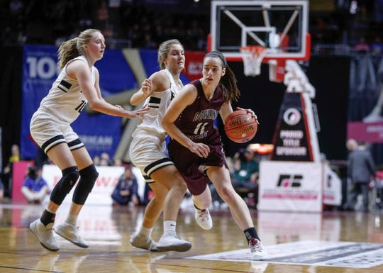 Dowling Catholic junior Caitlin Clark drives the ball in against Southeast Polk in their Class 5A state semifinal game on Thursday, Feb. 28, 2019, at Wells Fargo Arena in Des Moines.