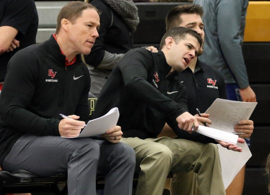 Grand View coach Nick Mitchell, left, coaches during the 2017 Grand View Open. Mitchell, along with assistant Paul Reedy, right, has led the Vikings to seven-straight NAIA national titles.