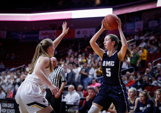 Des Moines Christian sophomore Megan Miller looks for an open teammate to make the pass against Center Point-Urbana in their Class 3A state semifinal game on Thursday, Feb. 28, 2019, at Wells Fargo Arena in Des Moines.