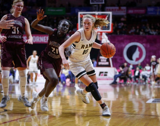 Southeast Polk sophomore Grace Larkins drives the ball inside against Dowling Catholic in their Class 5A state semifinal game on Thursday, Feb. 28, 2019, at Wells Fargo Arena in Des Moines.