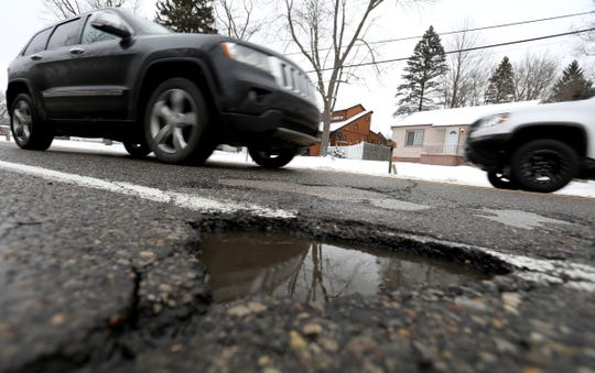One of several potholes found on Crescent Lake Road in Waterford, Michigan on Wednesday, February 27, 2019.Many people that run over potholes and get damage to their tires or rims have a hard time getting various cities to pay for damages.