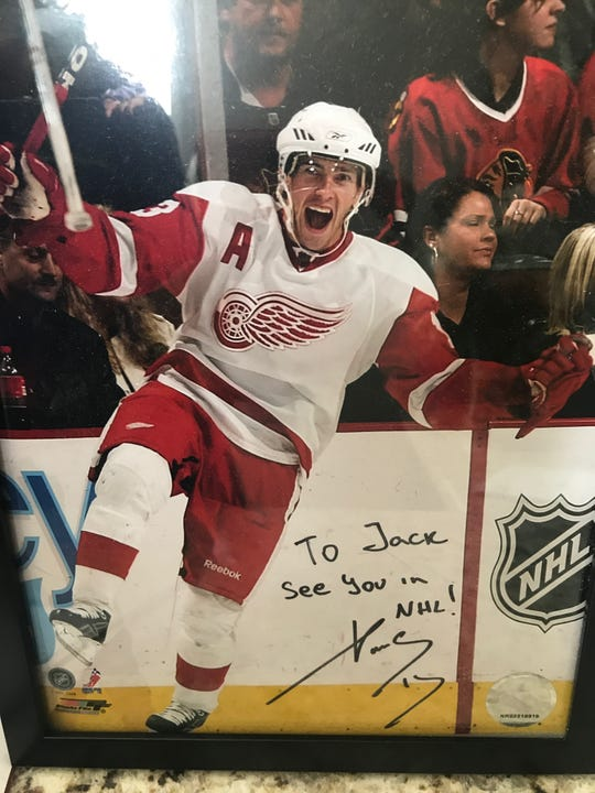 Jack Hughes' autographed photo of Wings great Pavel Datsyuk.