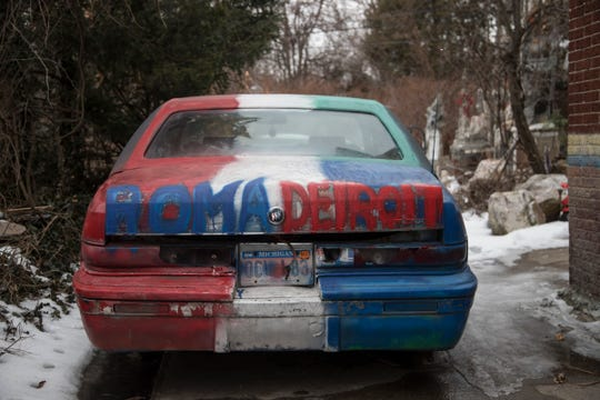 "A Buick painted with red, white, blue and green and the words ""Roma Detroit"" sits in Silvio Braile Sr.'s backyard in Redford, Saturday, Feb. 23, 2019."