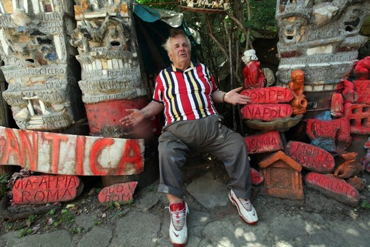 Silvio Barile sits on his fabricated Apiantica Rd. at his Italian-American Artistic Historical Museum in Redford, Mich., Wednesday, June 28, 2011.  SUSAN TUSA\Detroit Free Press