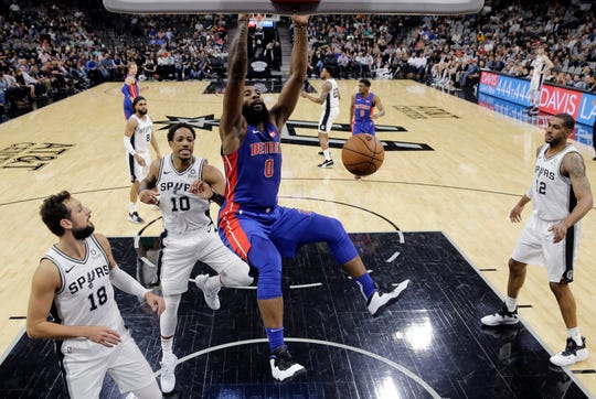 Detroit Pistons center Andre Drummond (0) scores past San Antonio Spurs guard DeMar DeRozan (10) during the first half of an NBA basketball game in San Antonio, Wednesday, Feb. 27, 2019.