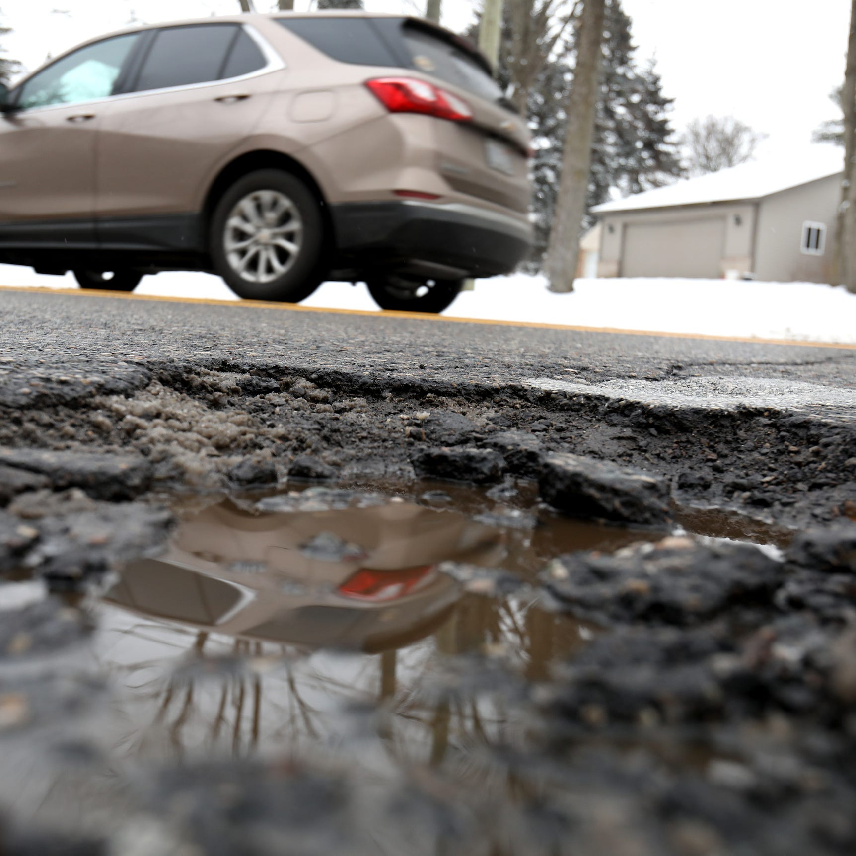 Slingshot effect? What happens when a car hits a pothole