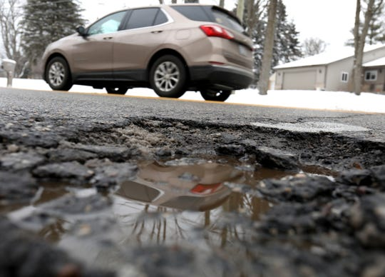 One of several potholes found on Crescent Lake Road in Waterford on Wednesday. Many people who run over potholes and damage their tires or rims have a hard time getting reimbursed by the government.