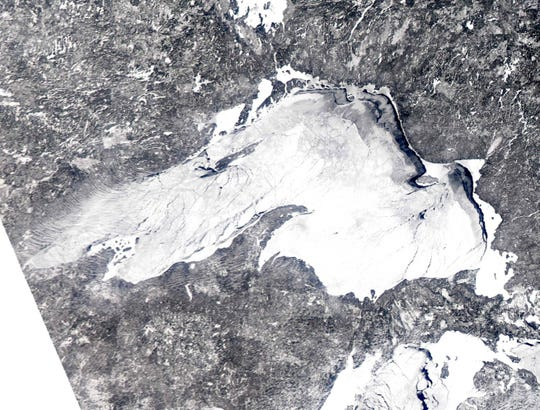 In this Feb. 16, 2014 satellite image provided by the NOAA Great Lakes CoastWatch is the ice cover on Lake Superior.