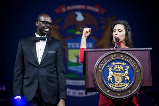 Gov. Gretchen Whitmer speaks next to Lt. Gov. Garlin Gilchrist II during the inaugural ball at Cobo Center in Detroit on Jan. 1, 2019.