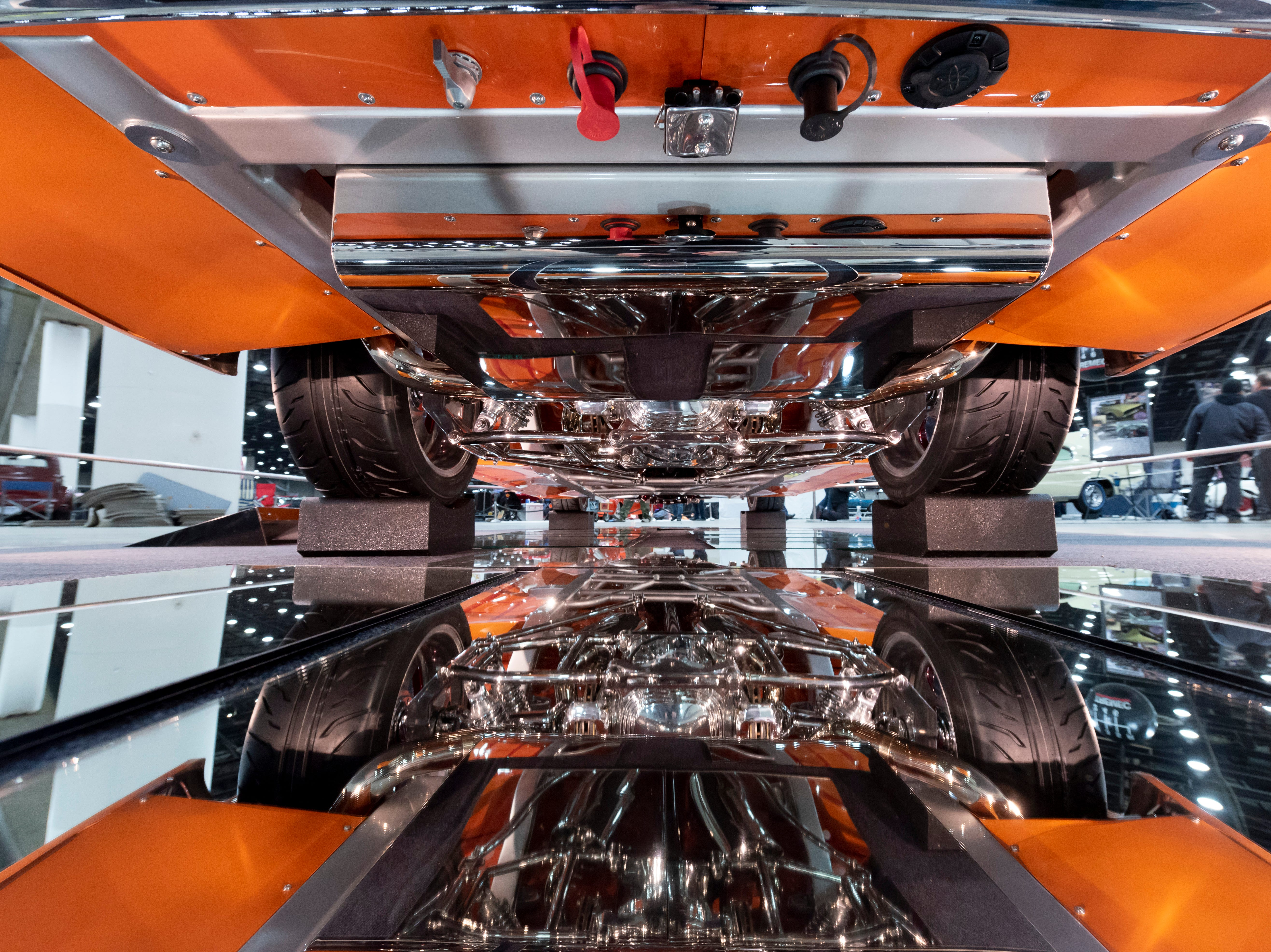 The undercarriage of a 1955 Chevy owned by Rick Bird, of Genshaw, PA. is reflected in mirrors lying on the floor at Detroit Autorama.