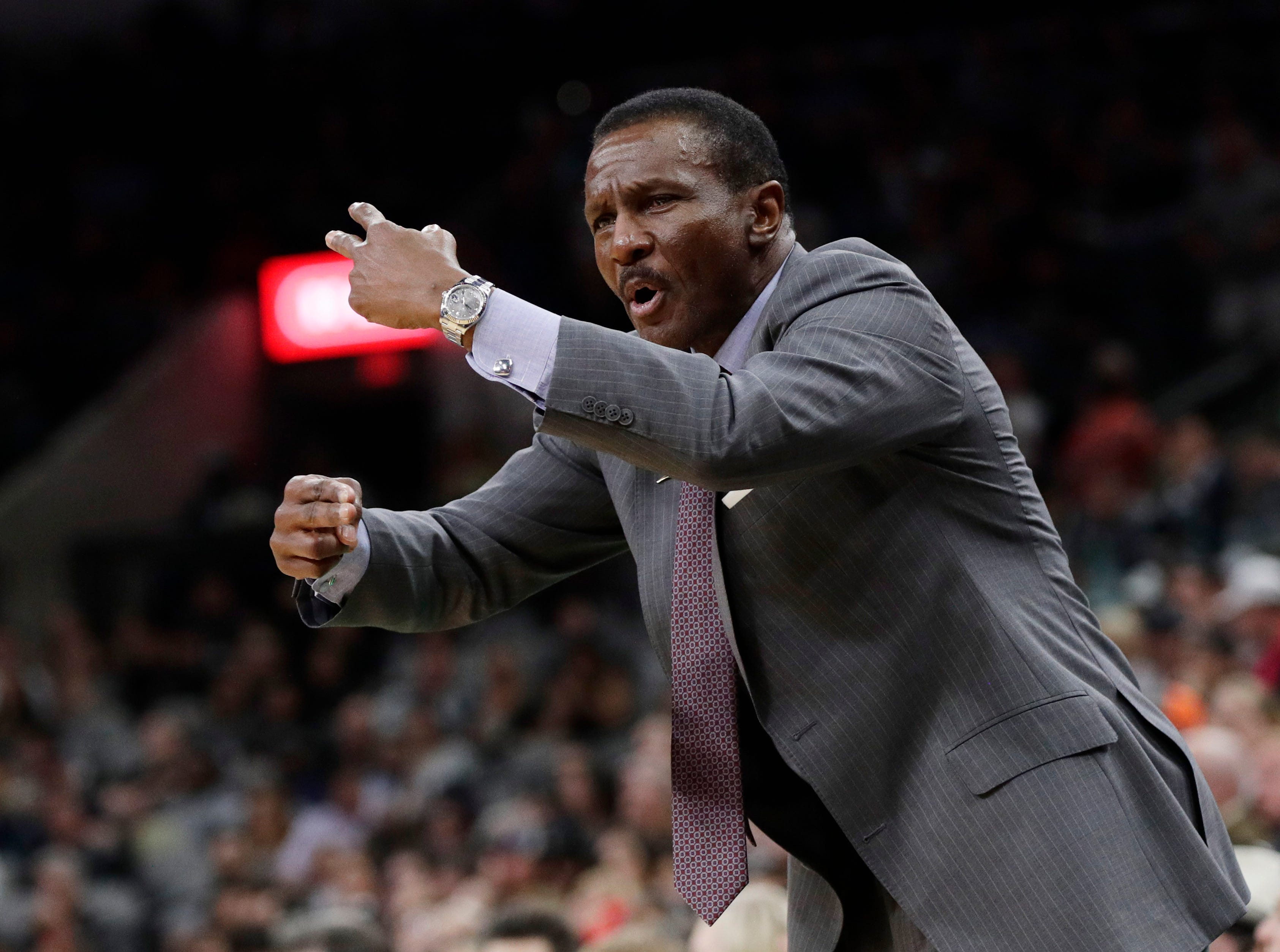 Detroit Pistons coach Dwane Casey talks to his players during the second half.