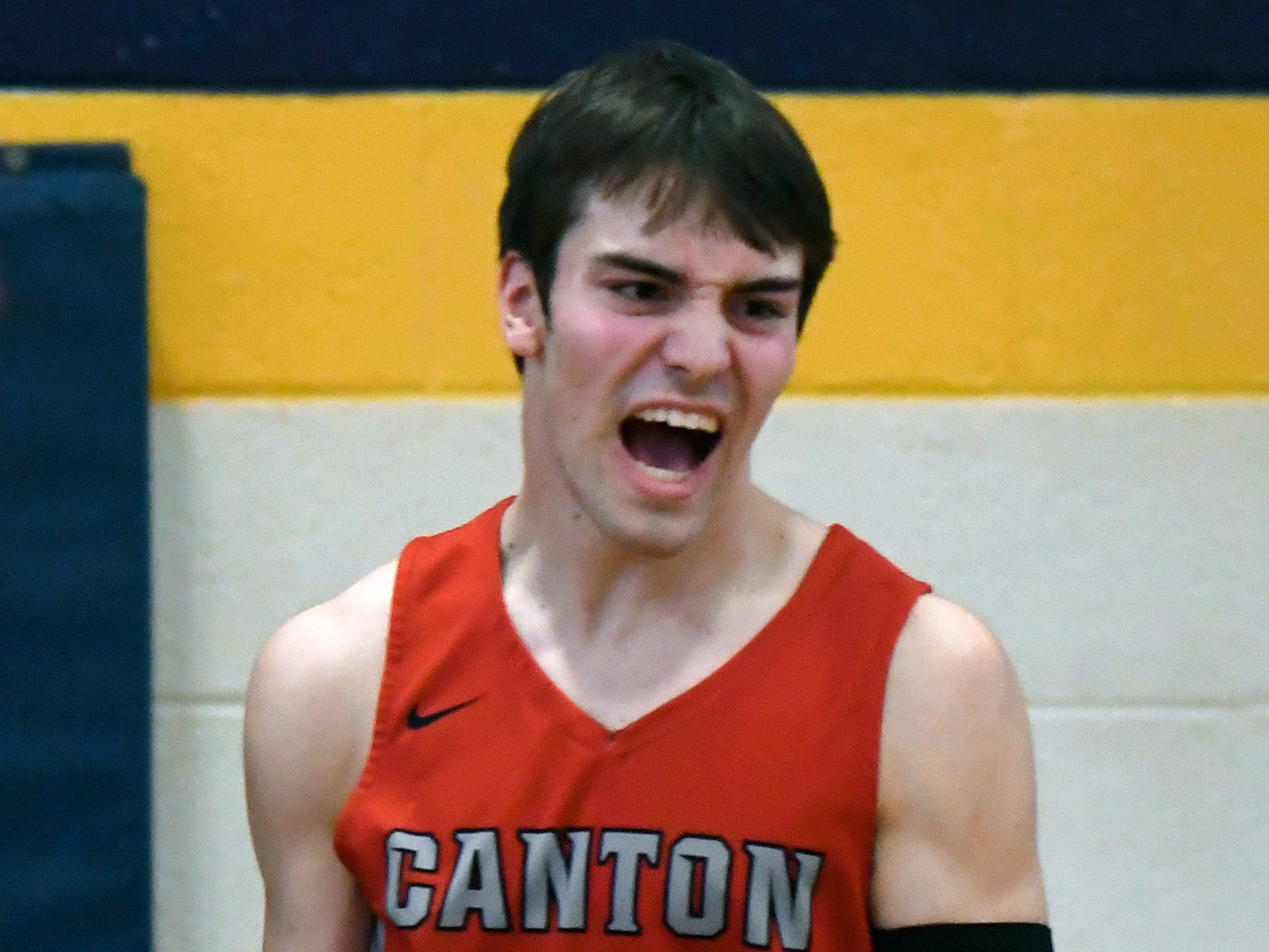 Canton forward Liam Radomski reacts after being fouled on a made shot against Westland John Glenn during the first quarter.