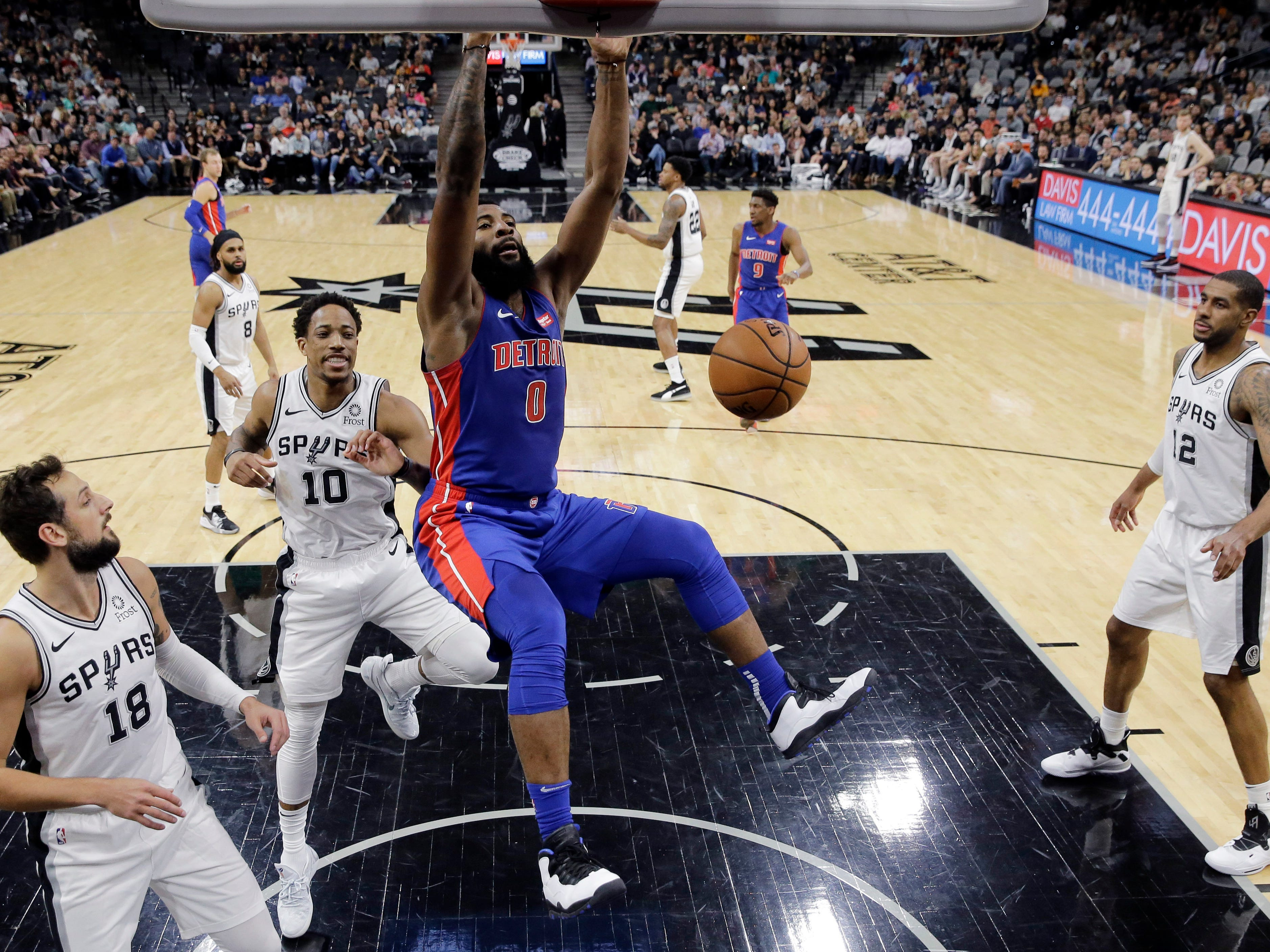 Detroit Pistons center Andre Drummond scores past San Antonio Spurs guard DeMar DeRozan (10) during the first half in San Antonio, Wednesday, Feb. 27, 2019.