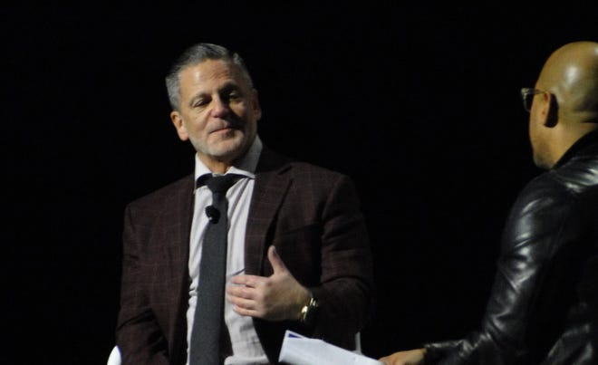 Quicken Loans founder and chairman Dan Gilbert speaks with Dennis Archer Jr., CEO of Ignition Media Group, at the Detroit Regional Chamber's Detroit Policy Conference.