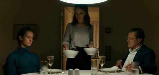 "Tom Schilling, left, Paula Beer and Sebastion Koch star in ""Never Look Away."""