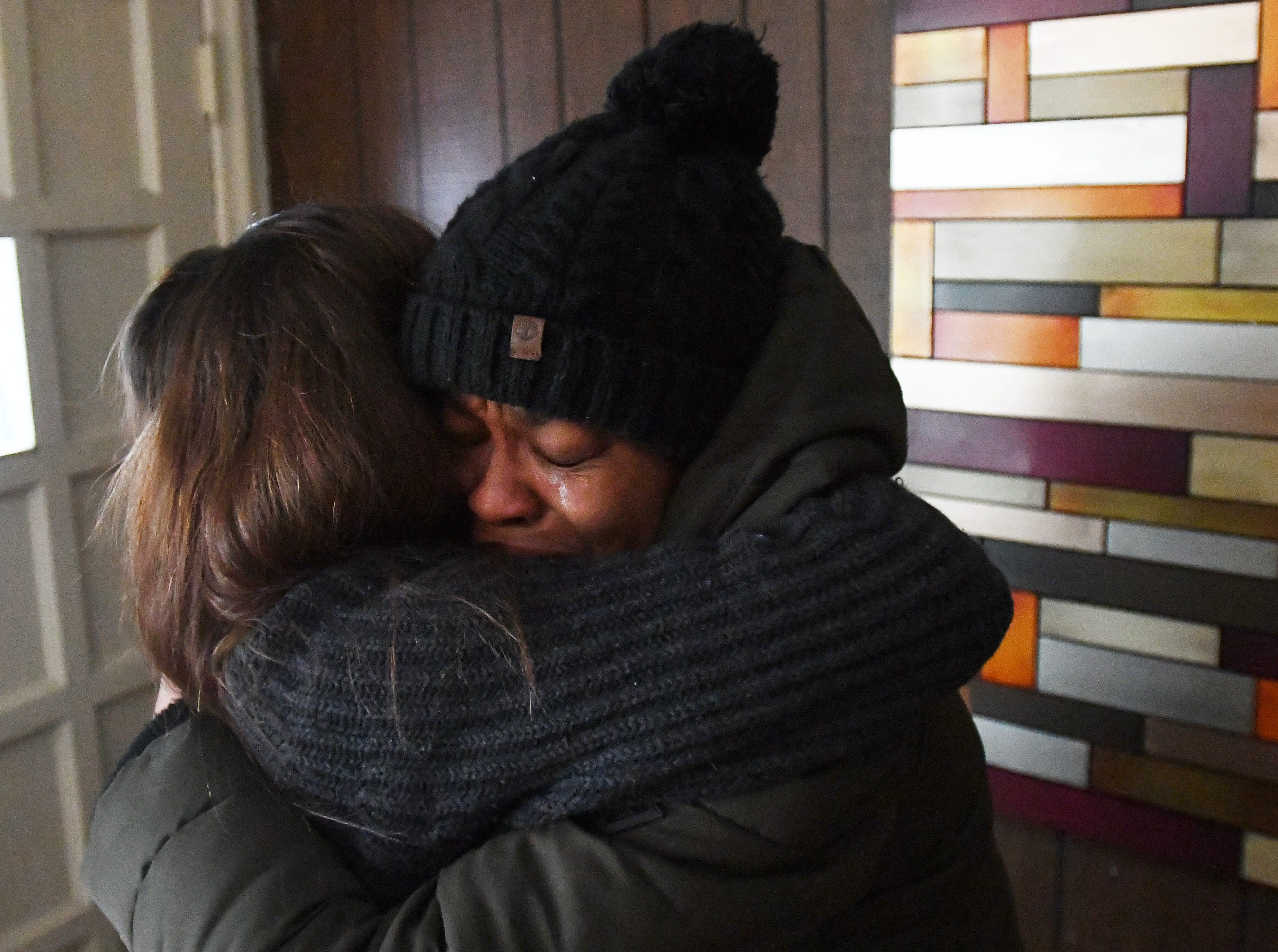 Humble Design CEO and co-founder Treger Strasberg is hugged by a tearful Jamiliah Powers-McCoy as she walks into her newly-furnished home. United Community Housing Coalition helped Ms. Powers-McCoy secure a loan to purchase the home from the city of Detroit but did not have any further money to furnish it.  Humble Design, a nonprofit that furnishes homes for people coming out of homelessness, did the redesign, their 1000th home makeover.