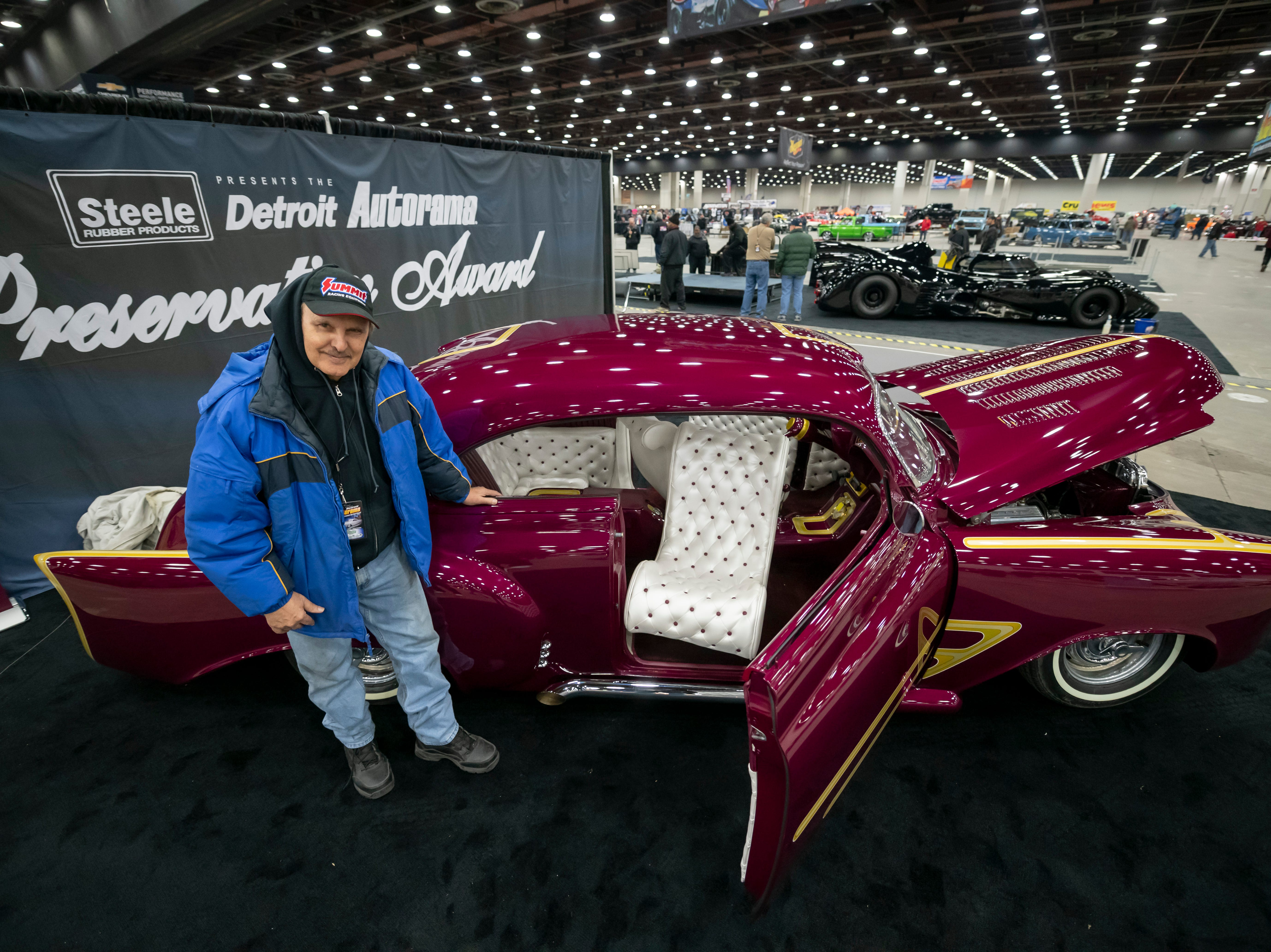 "Vehicle collector Carl Casper poses with his 1951 Chevy sedan at Detroit Autorama at Cobo Center in Detroit, February 28, 2019. The vehicle won the ""Best of Show"" award at the first Autorama in 1960."