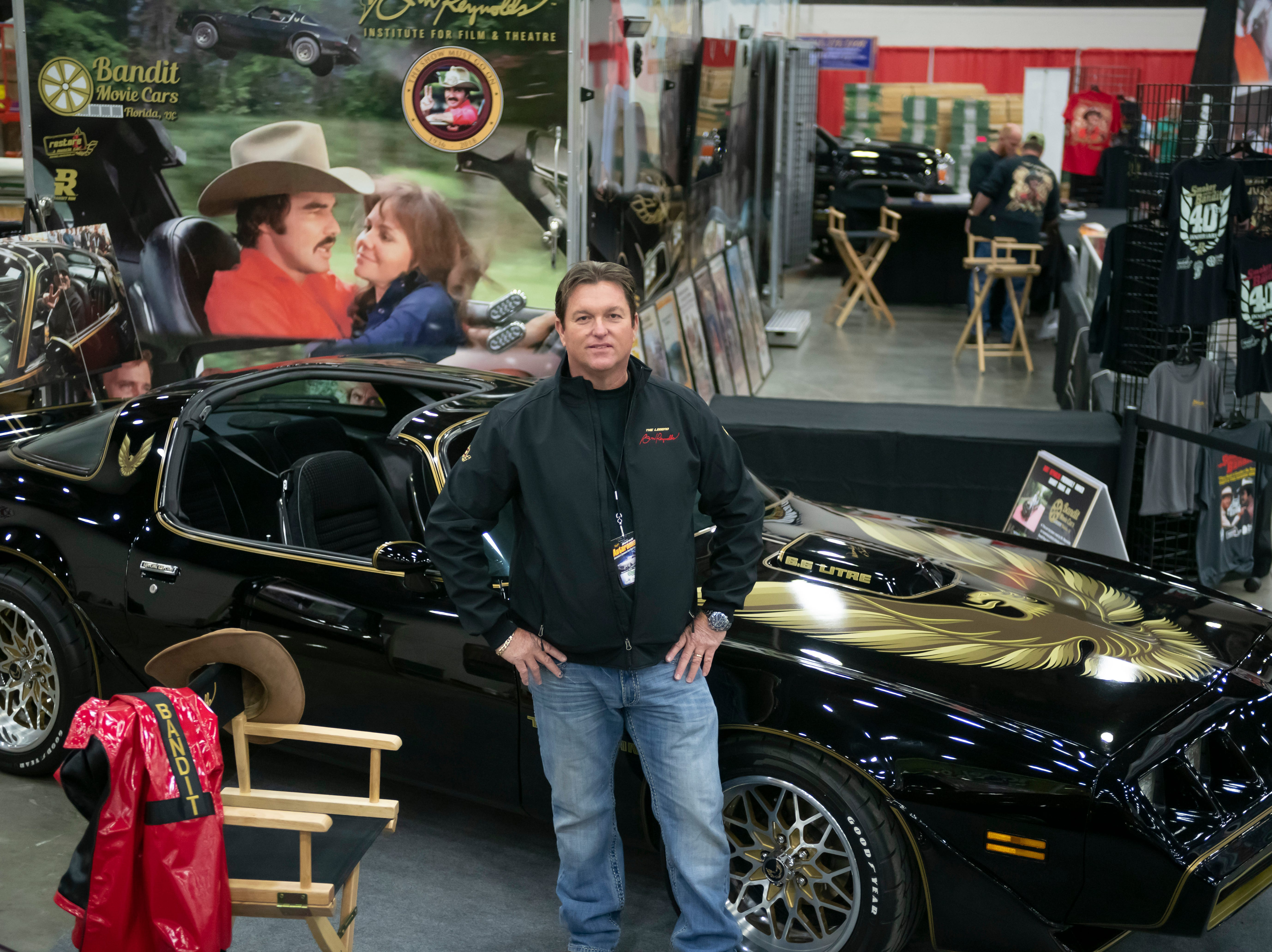 Gene Kennedy, manager of Bandit Movie Cars, stands next to a 1979 Pontiac Trans Am that was the personal vehicle of actor Burt Reynolds.